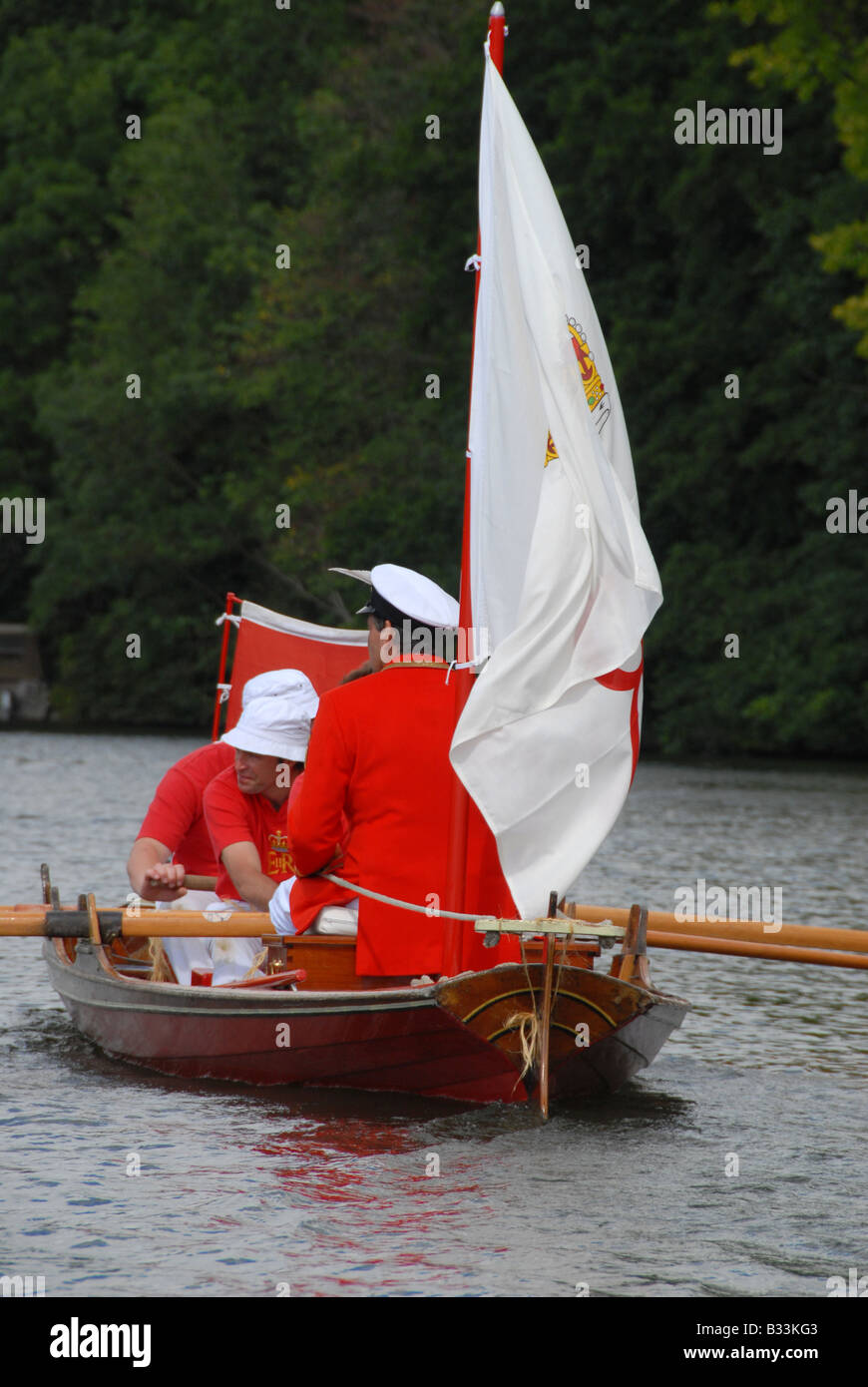 The Queen's swan marker, David Barber sitting at the helm of his skiff during the  Swan Upping on the River - Stock Image