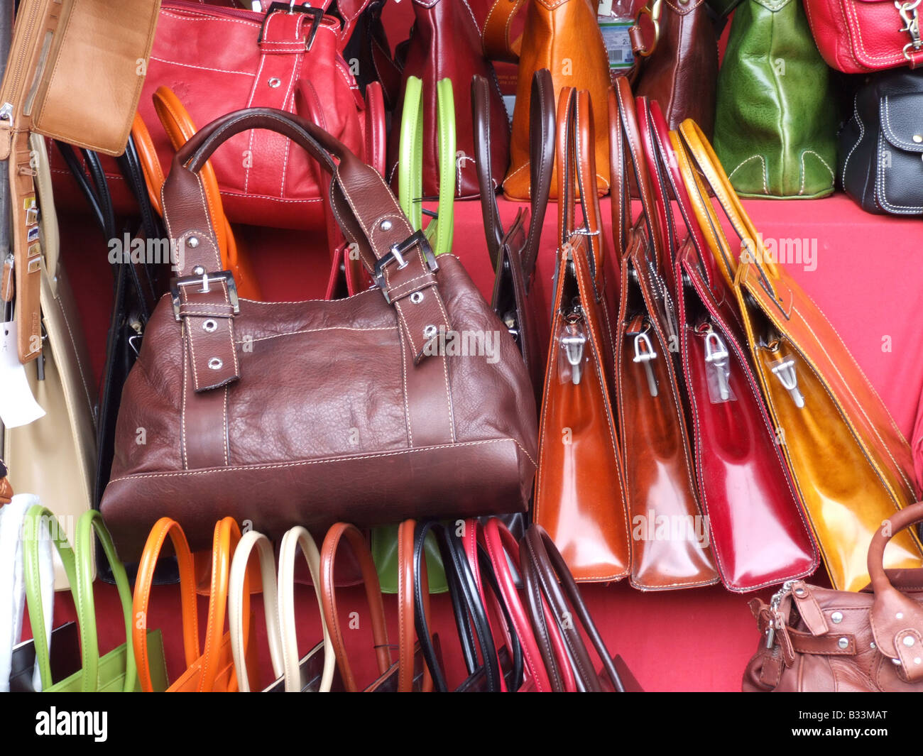 15460b11b8f10 leather hand bags in shop window in florence, italy Stock Photo ...