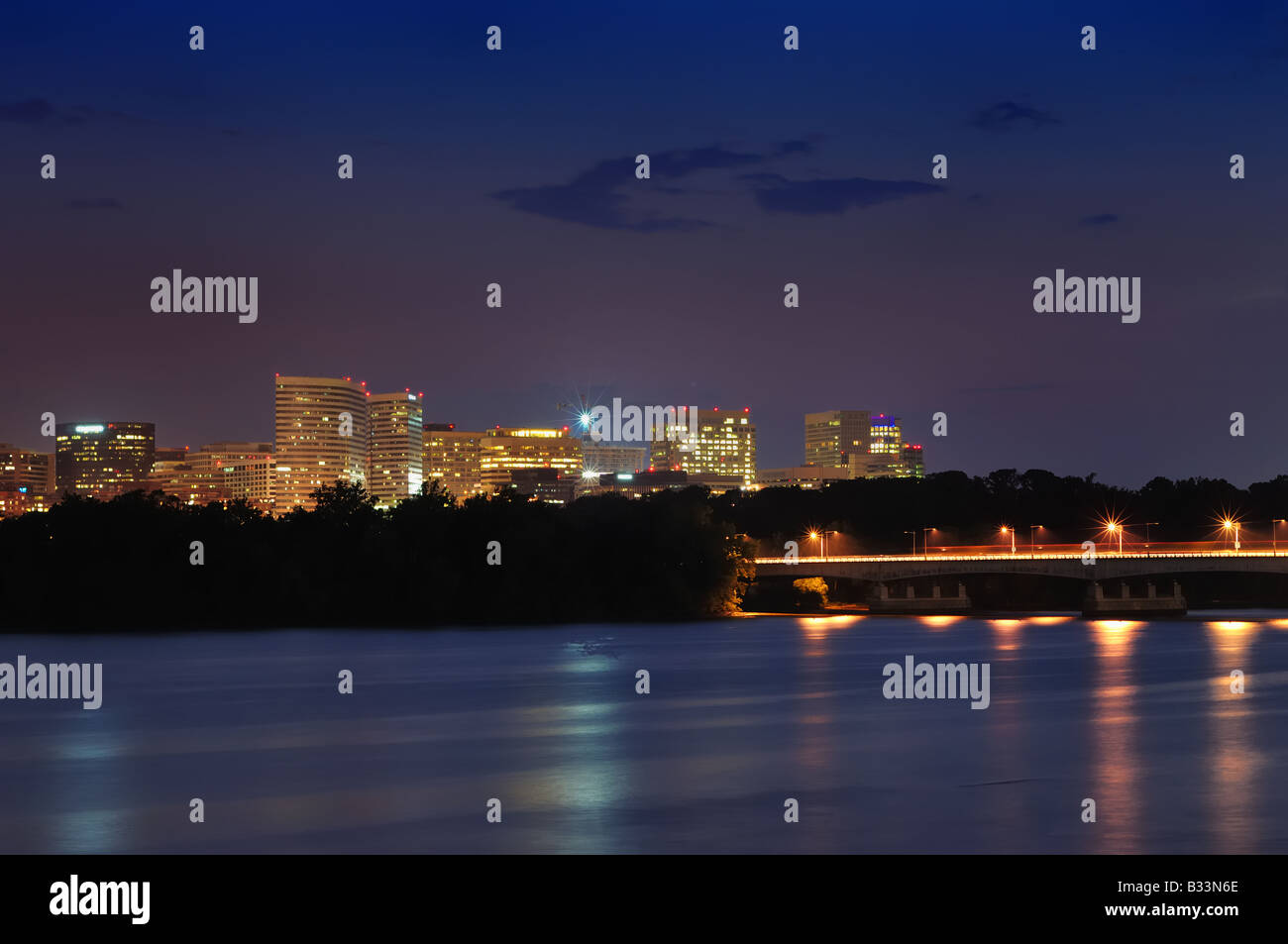 The waters of the Potomac River form a silky sheen in this long-exposure shot of the Rosslyn neighborhood of Arlington, - Stock Image