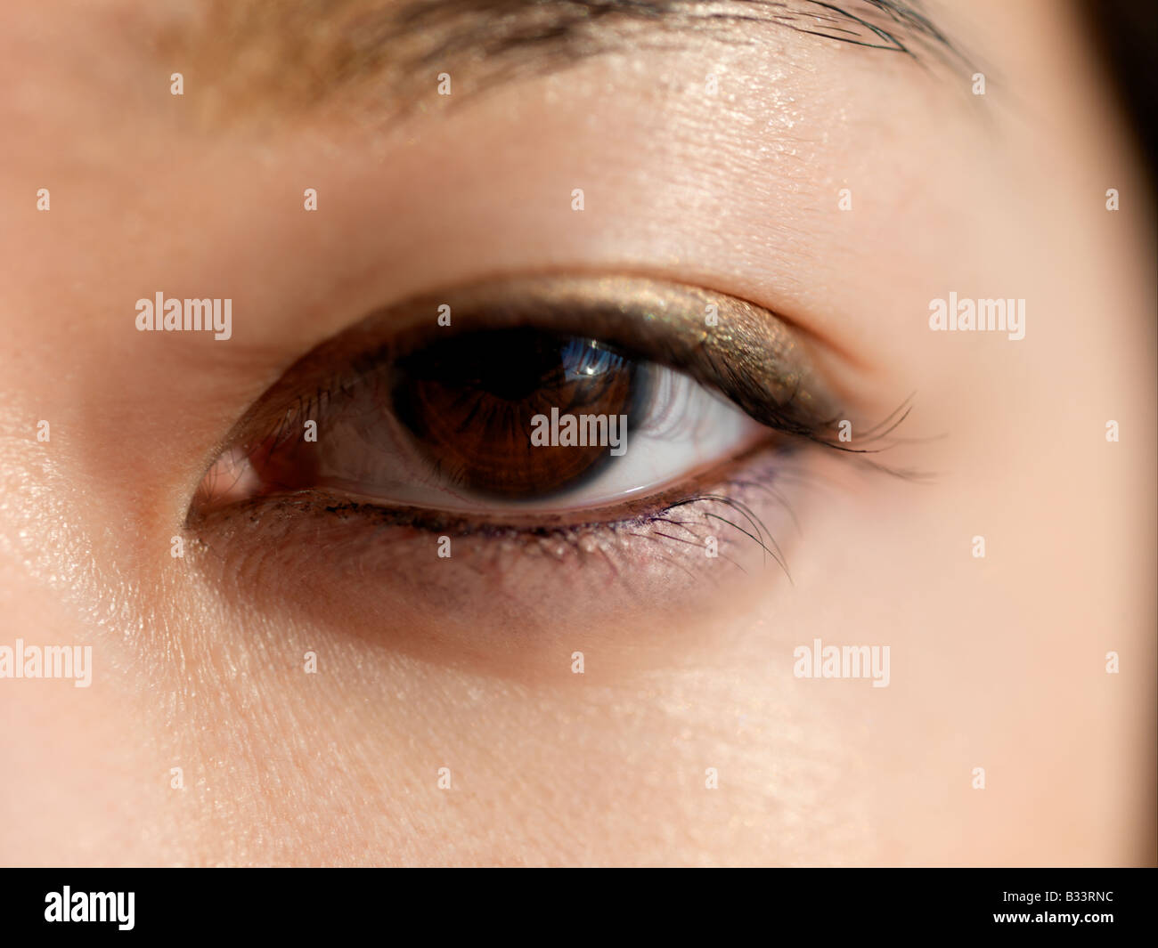 A close up of a young Asian's eye. - Stock Image