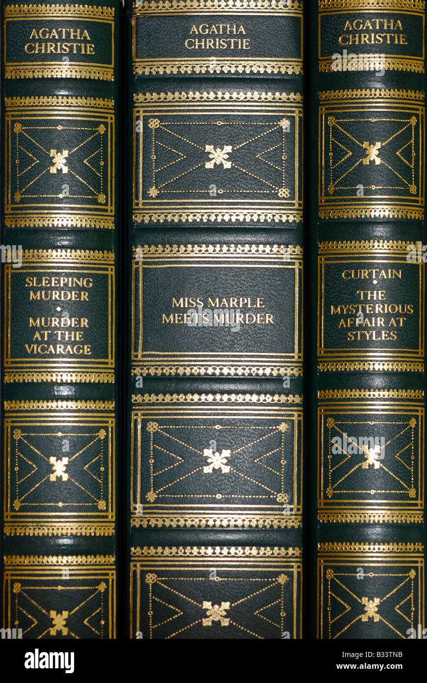 Book Spines of Leather Bound Books, Agatha Christie Stories - Stock Image