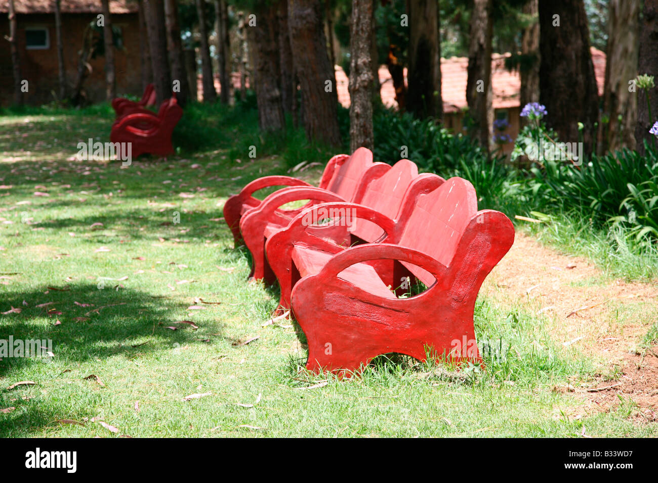 A Concrete Red Garden Bench In Ooty,india