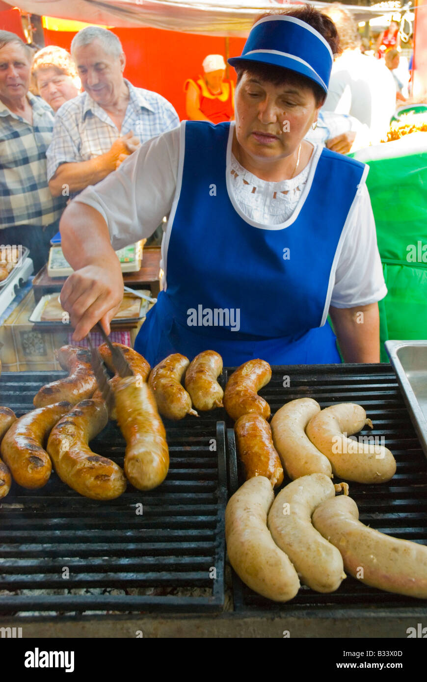 Grilling sausages at Piata Centrala marketplace in Chisinau Moldova Europe - Stock Image