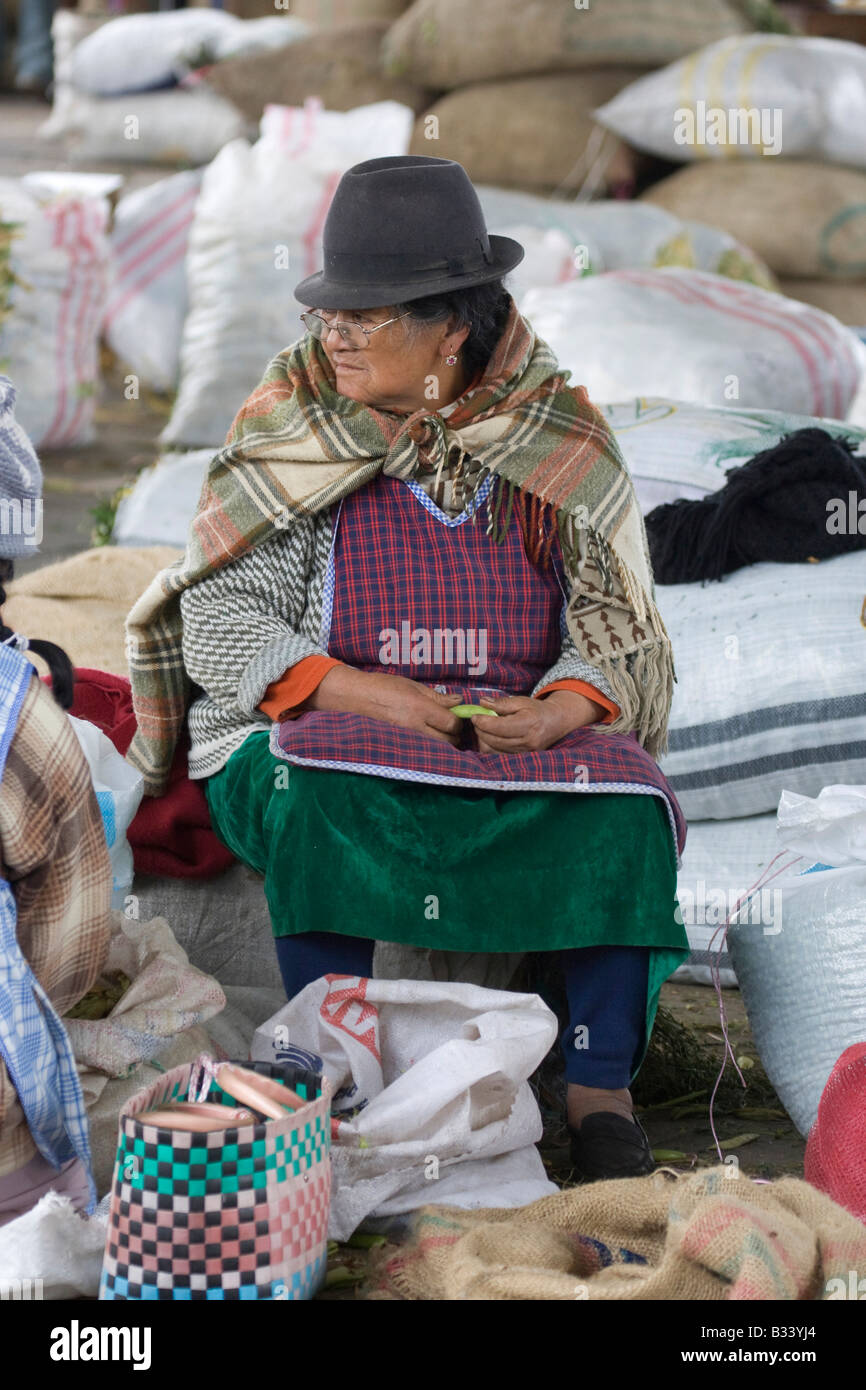 Woman in black hats and poncho,Guamote market, indian farmer
