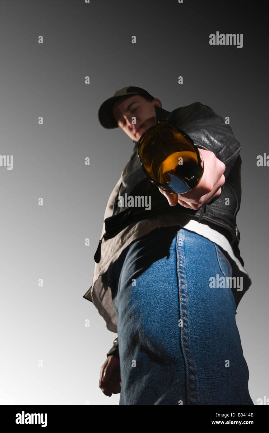Youth with broken bottle - Stock Image