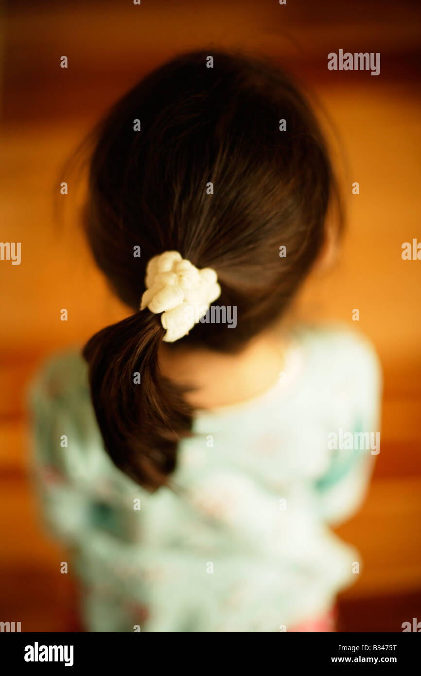 Ponytail hairstyle little girl aged five years - Stock Image