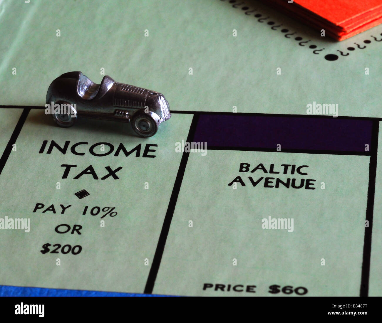 Income tax square on a Monopoly game board - Stock Image