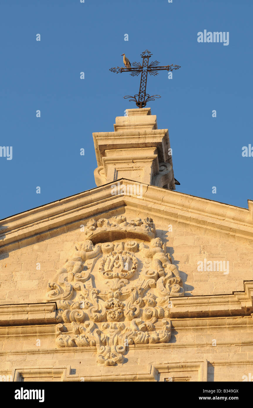 European White Storks CICONIA CICONIA perch on cross above the Cathedral Catedral Valladolid Spain Stock Photo