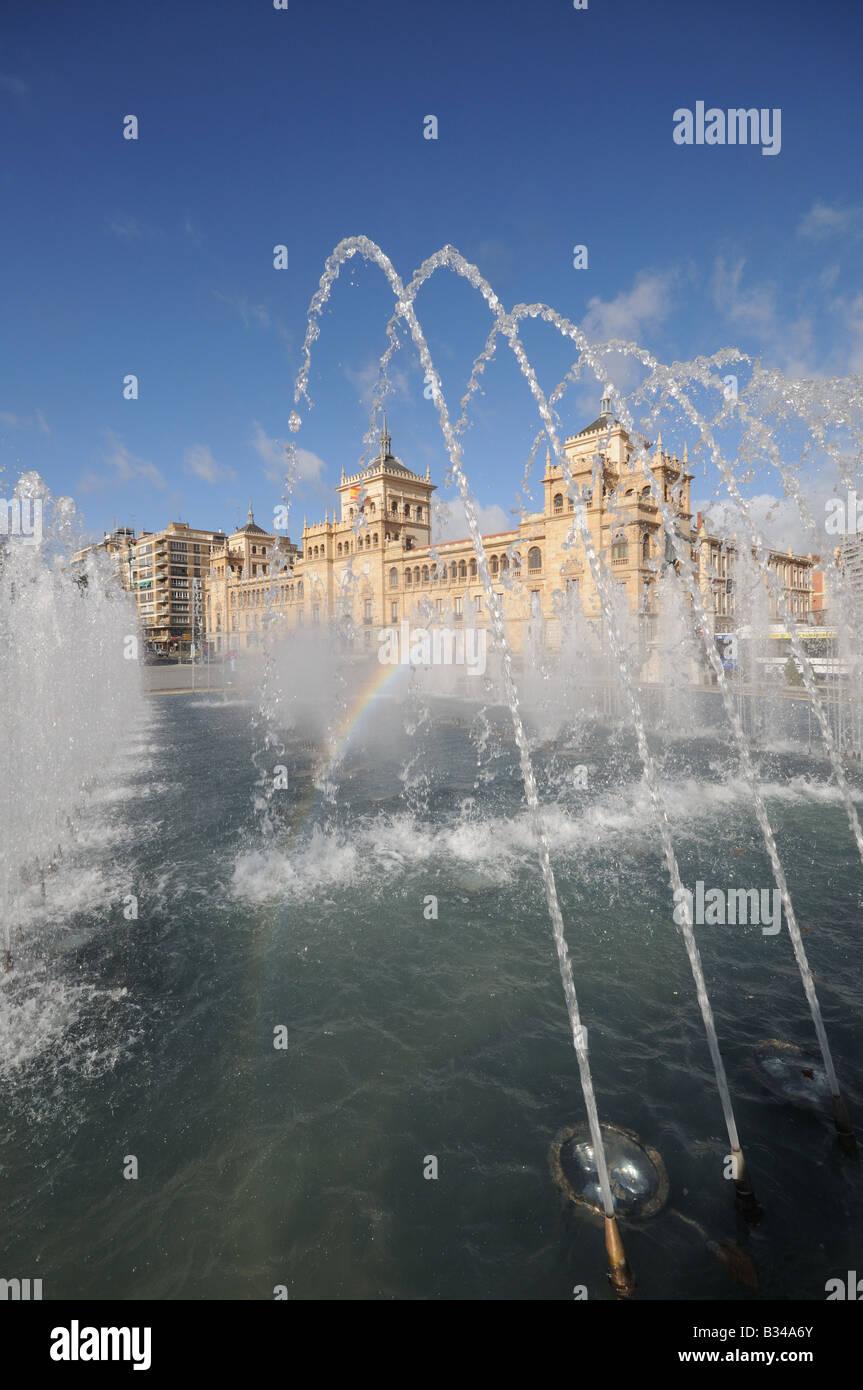 Fountains in the Plaza Zorrilla with the Academia del Arma de Caballería Academy of Armed Cavalry Valladolid - Stock Image