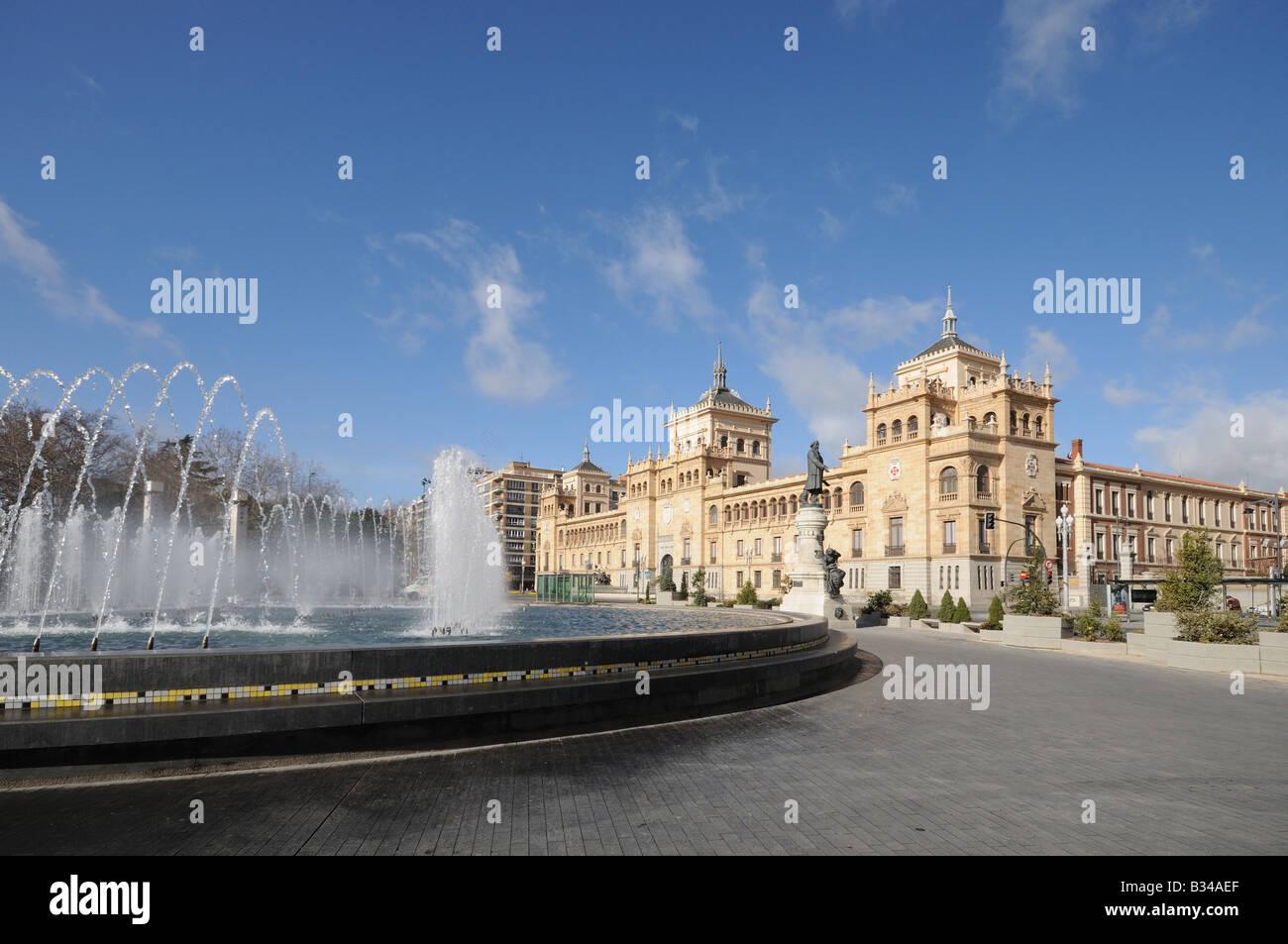 Plaza Zorrilla Valladolid Spain with fountains and statue of José Zorrilla with the Academia del Arma de Caballería - Stock Image