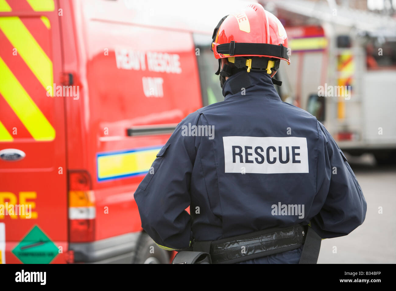 Rescue worker walking back to rescue vehicle - Stock Image