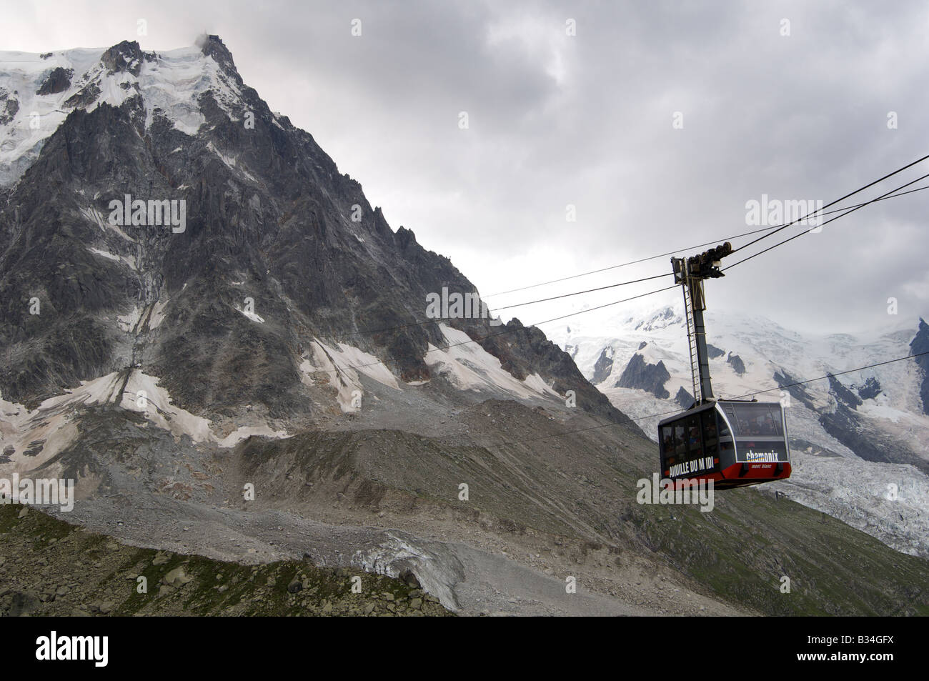 Aiguille Du Midi cable car, in bad weather, during th summer. - Stock Image