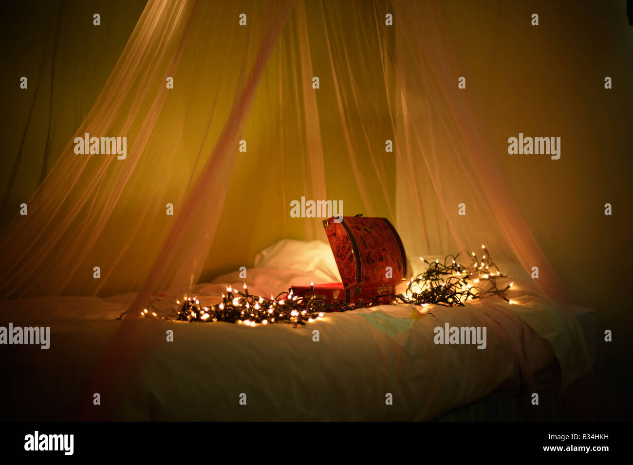 Open box with lights on bed with canopy - Stock Image