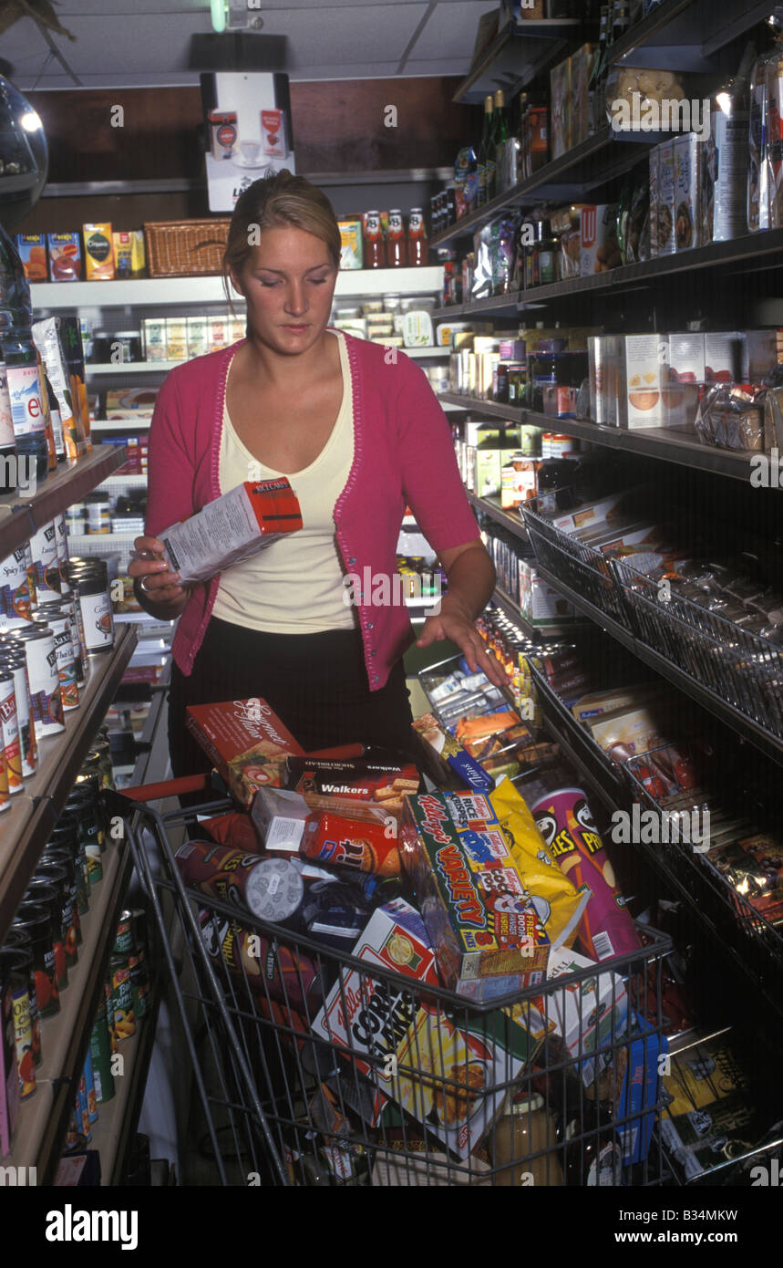 50fa023019 woman buying luxury goods in grocery shop Stock Photo  19158381 - Alamy