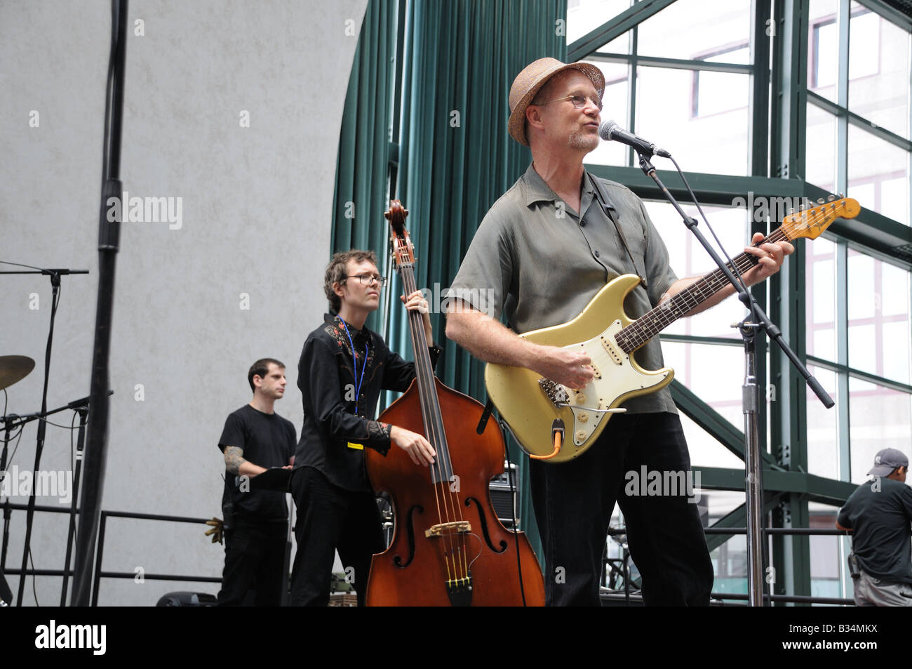 Marshall Crenshaw and other musicians rehearsing for a pop/folk concert at the Winter Garden in Battery Park City, - Stock Image