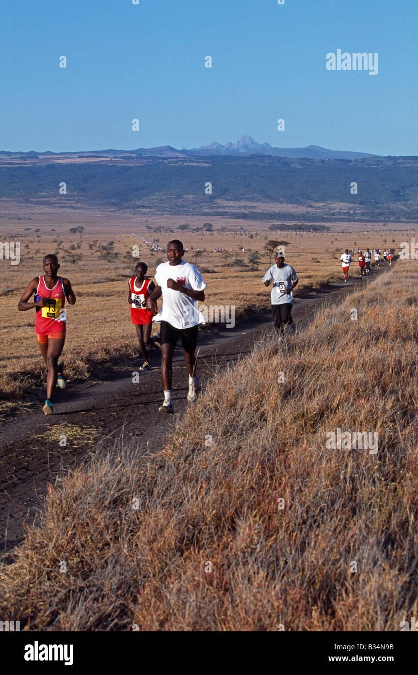 Kenya, Lewa Wildlife Conservancy, Safaricom Marathon. Runners approaching the 5km mark in the safaricom Marathon, Stock Photo