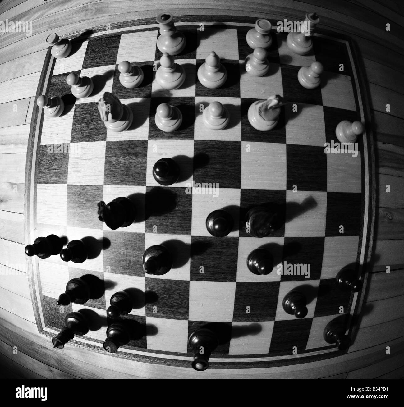 wide angle detailed images of various chess pieces, queen, king, paws, black and white on a chessboard, resign defeat, Stock Photo