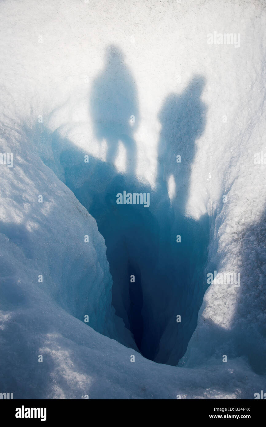 A view looking down into a crevasse on the Perito Moreno Galciar in Los Glaciares National Park, Patagonia in Argentina. Stock Photo