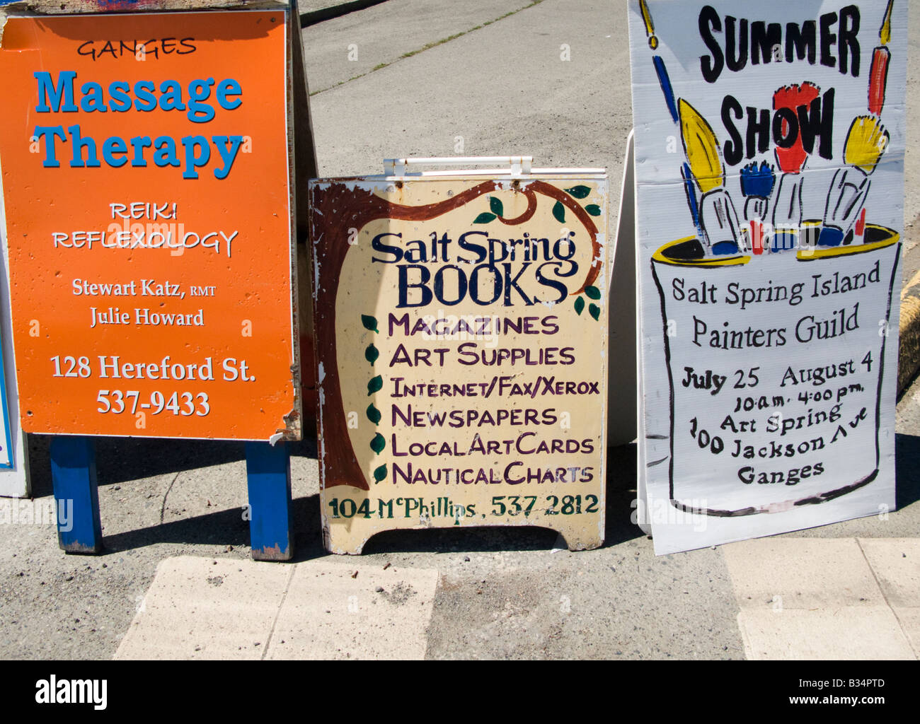 'Signboards advertising local shops and services in Salt Spring Island Canada' - Stock Image