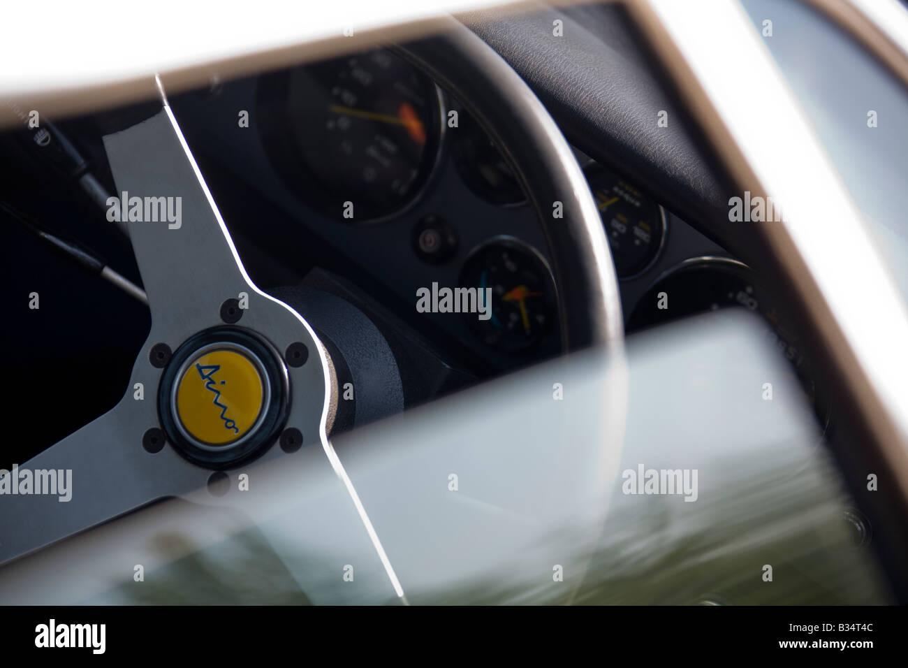 Ferrari Dino steering wheel through window - Stock Image