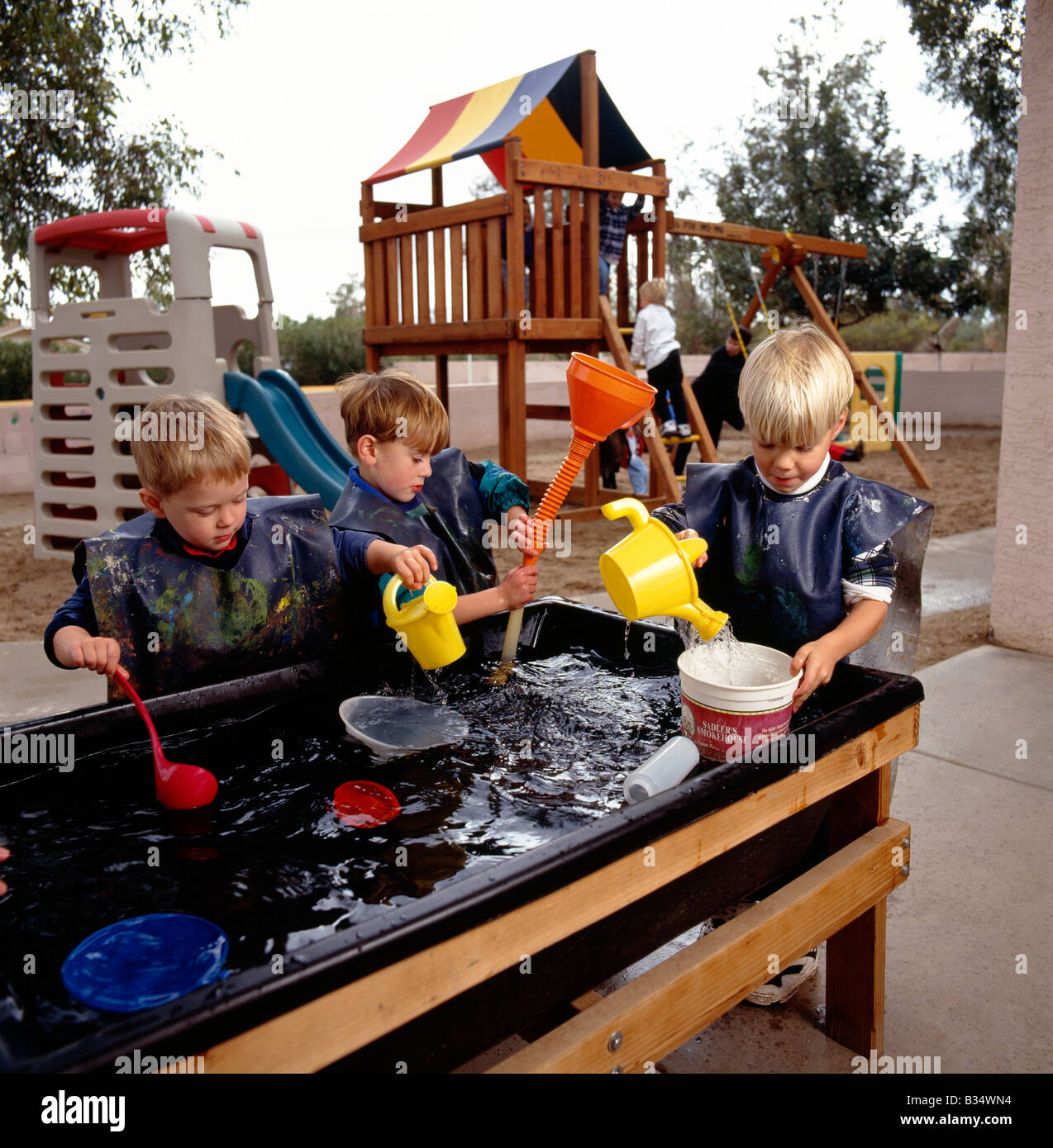 Kinder Garden: Young Children Playing At A Water Table Game In An Arizona
