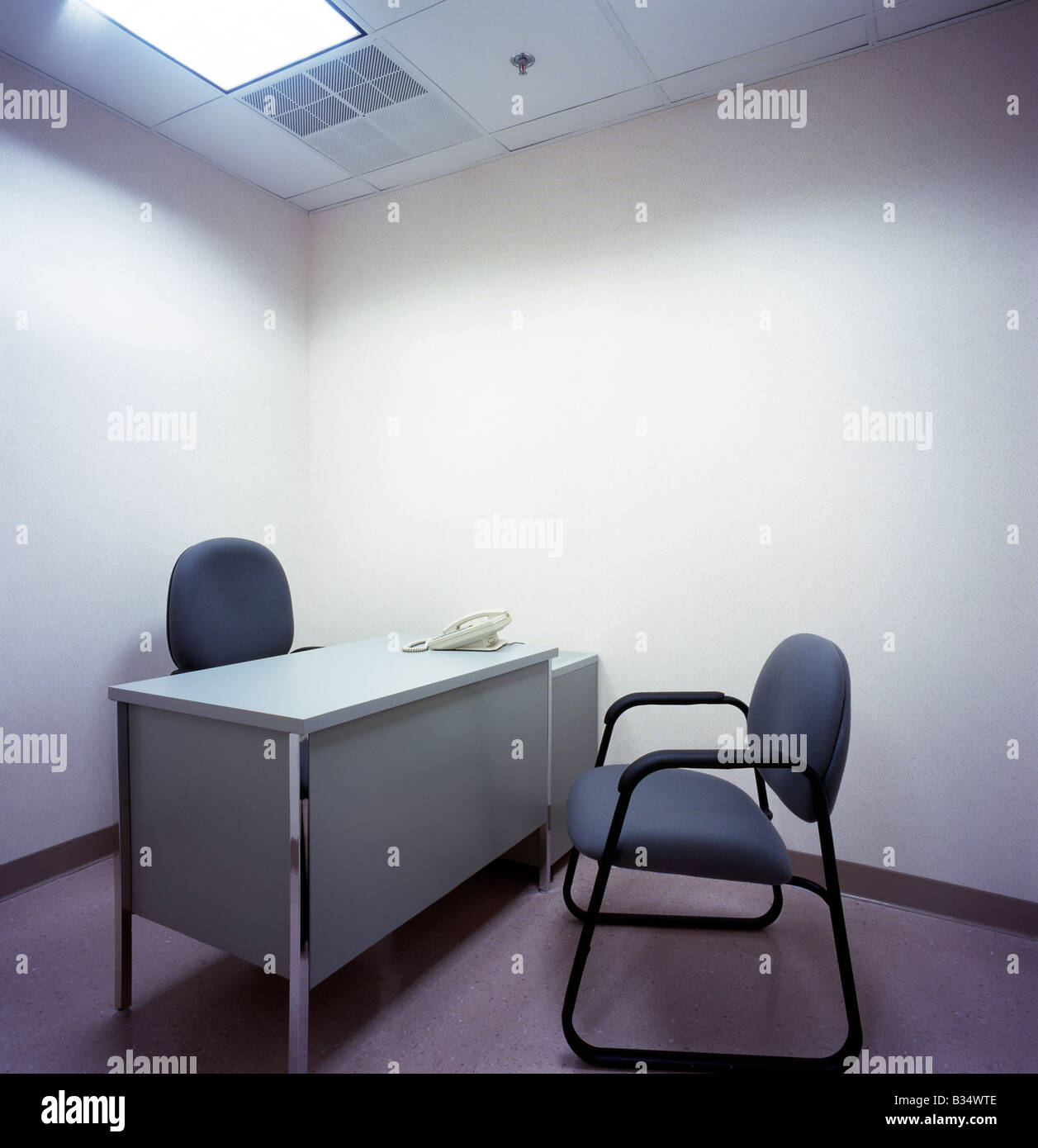 office desk for two. Spartan Office Containing Only A Desk, Two Chairs And Telephone Desk For I