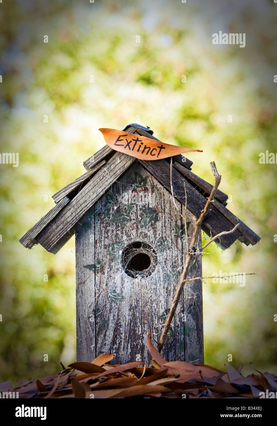birdhouse with extinct sign - Stock Image