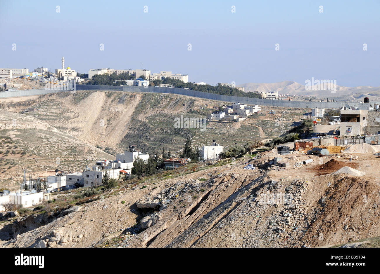 The controversial Separation Wall/Security Barrier built by the Israeli government, pictured in South East Jerusalem. - Stock Image