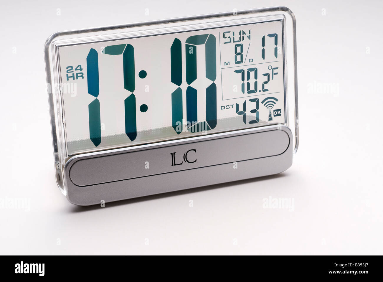 Clear radio controlled alarm clock with thermometer - Stock Image