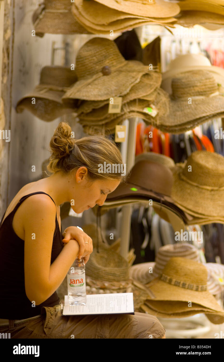 Stallkeeper selling hats Hvar Croatia - Stock Image