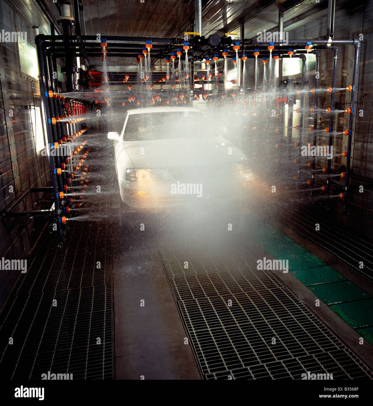 High pressure water used to test new automobile for leaks in an auto manufacturing plant Stock Photo