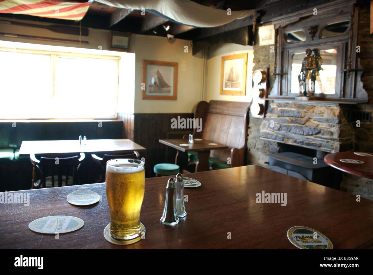 Pint of lager, Ferry Inn interior, Salcombe, Devon, UK - Stock Image