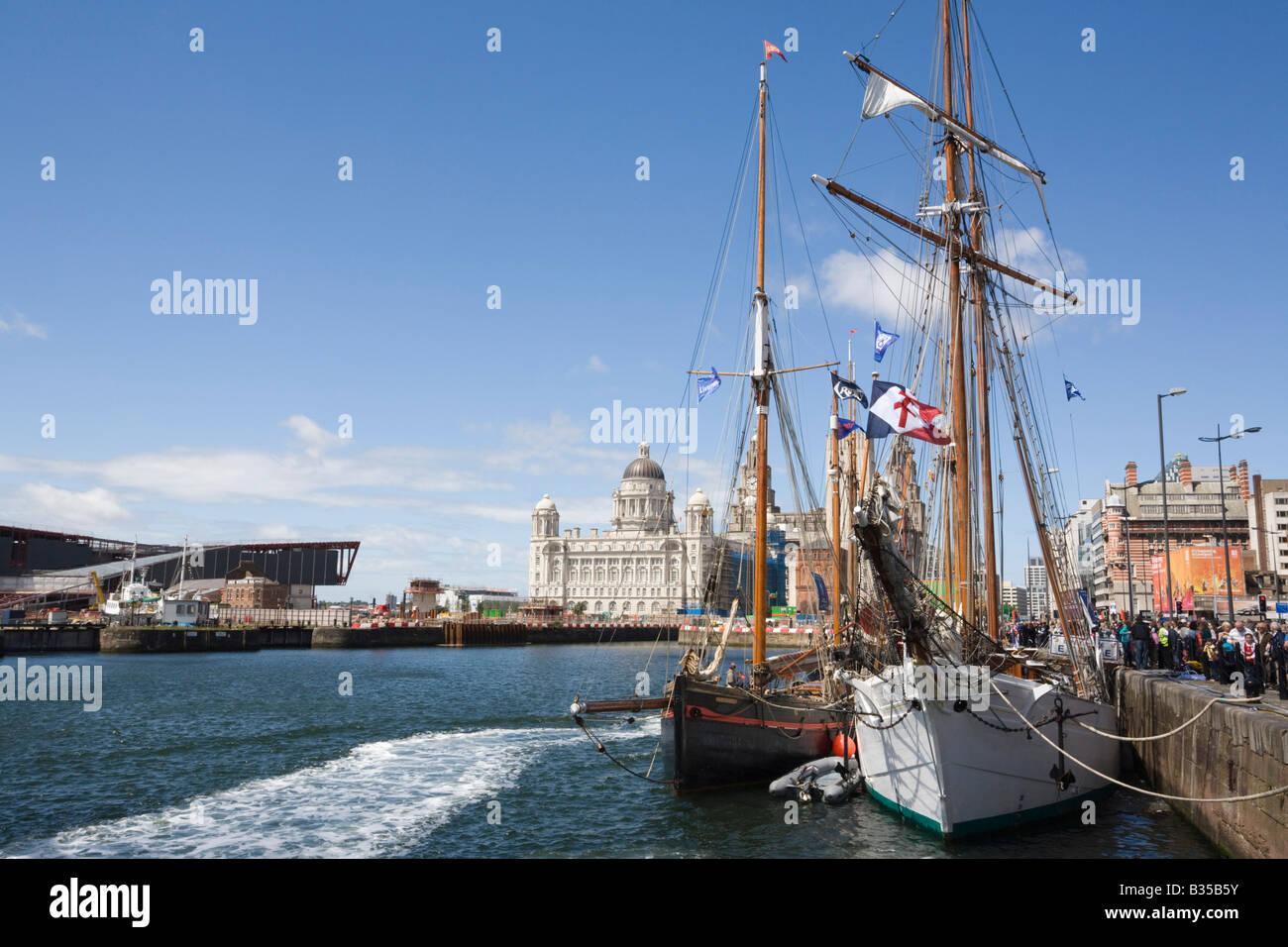 Liverpool Merseyside England UK July Tall Ships moored in Canning Dock on waterfront with Port of Liverpool building - Stock Image