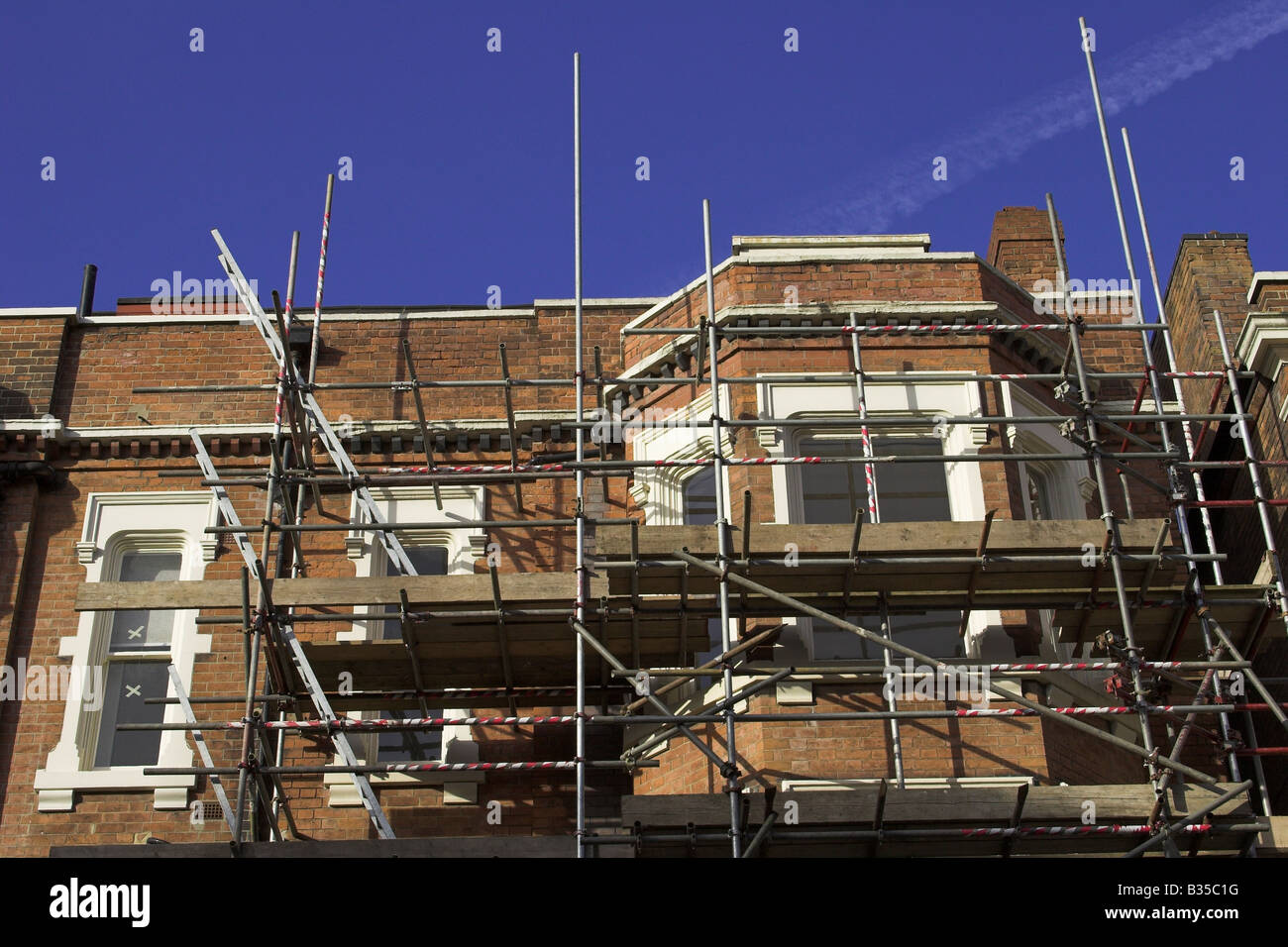 Scaffolding on a renovated house in a U.K. city. - Stock Image