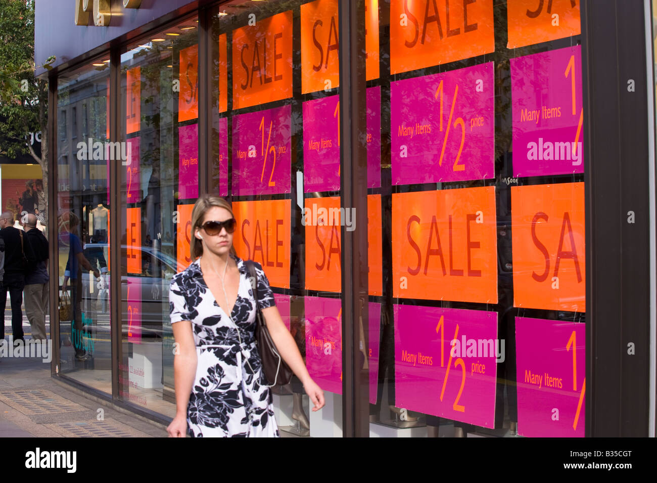 People shopping on King's Road during summer sales Chelsea SW3 London United Kingdom - Stock Image