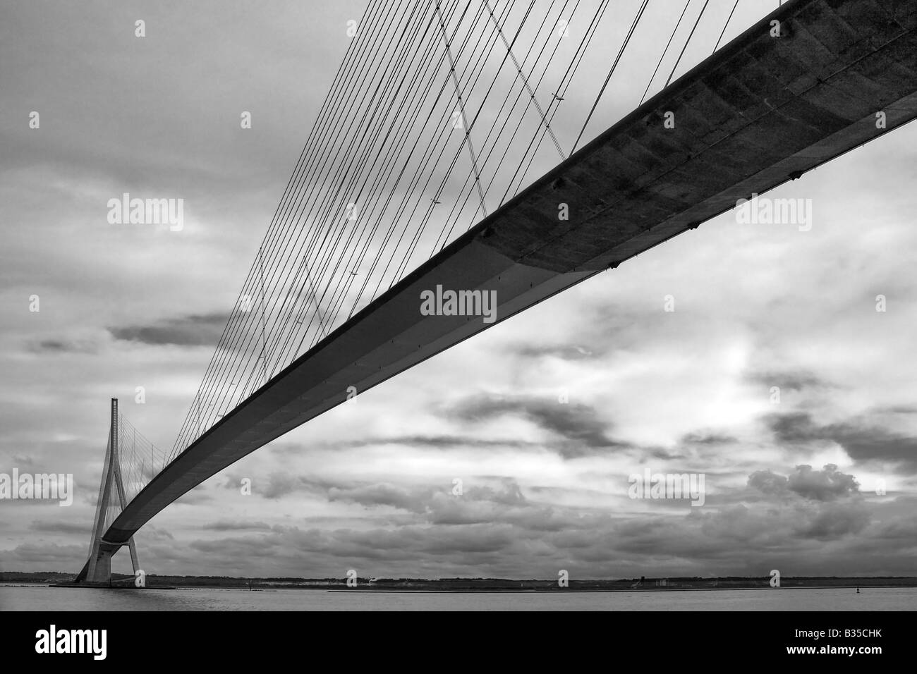 A moody black and white representation of the Pont de Normandie near to Honfleur in Normandy, France - Stock Image