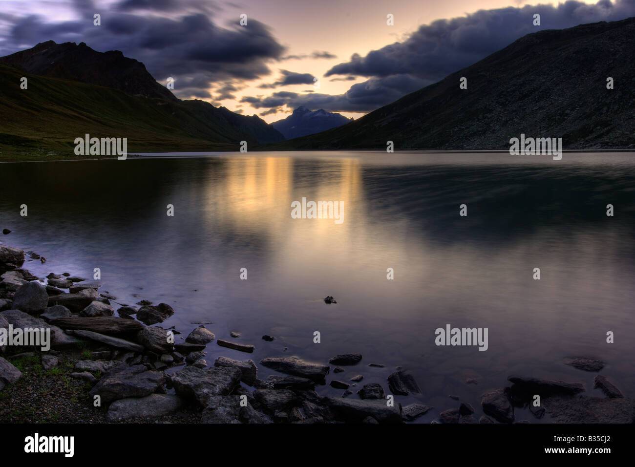 A pre dawn representation of the Nivolet Lake, an alpine glacial lake in the heart of the Gran Paradiso National - Stock Image
