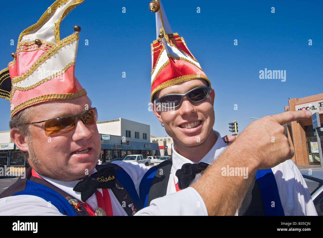Two local men from Swakopmund coastal Namibia town are heading for local German Kuska carnival - Stock Image