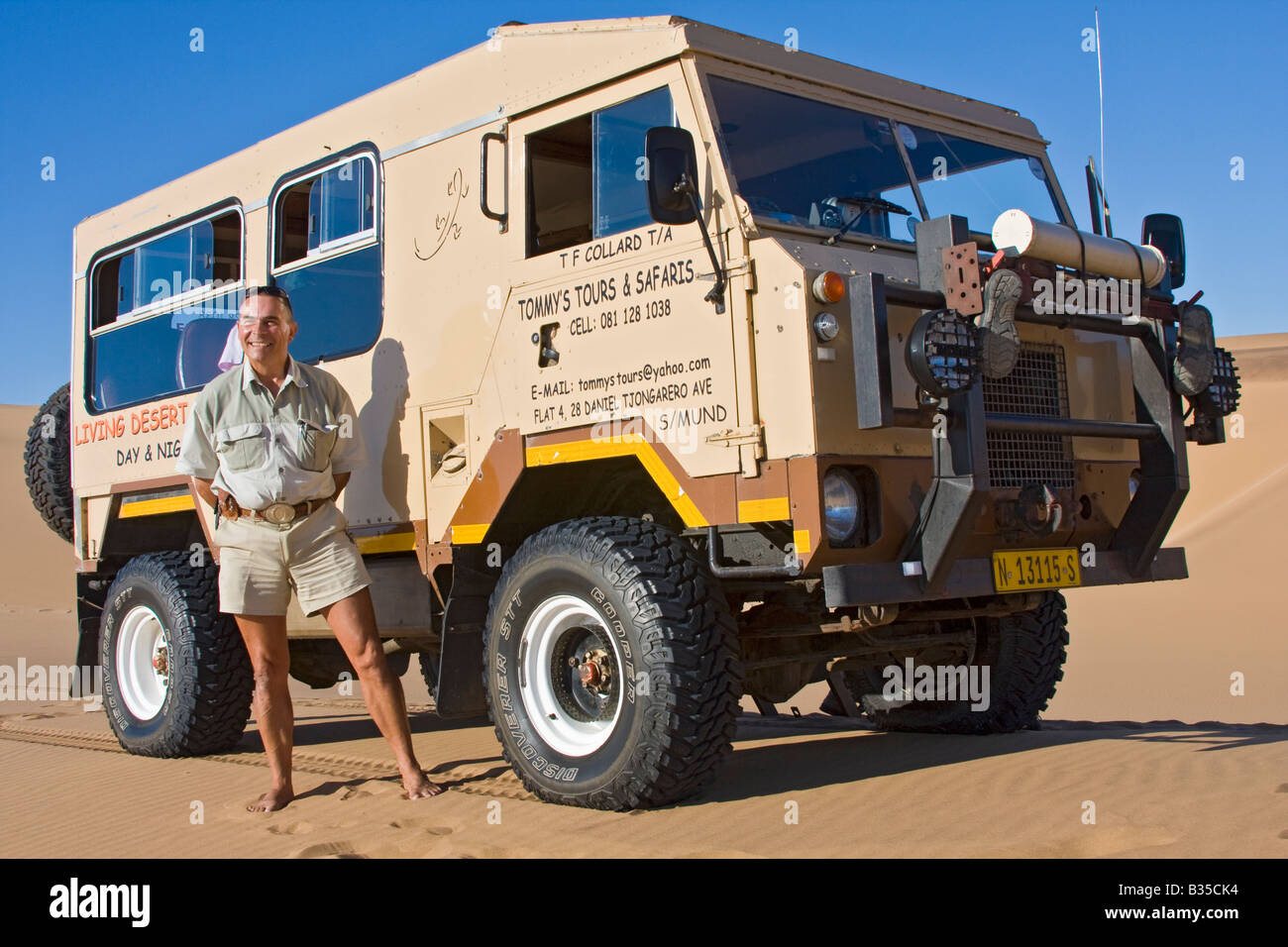Tommy leads his Living Desert Tours across sand dunes outside Swakopmund popular tourist town along Namibian coast - Stock Image
