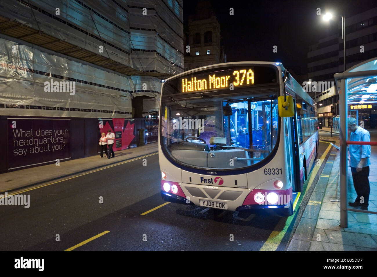 Night bus in the city centre, Leeds, West Yorkshire, England Stock Photo