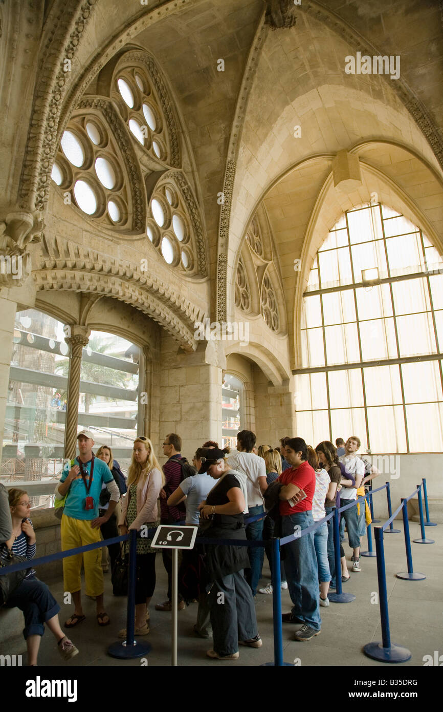 Spain Barcelona Visitors Wait In Line For Elevator In Sagrada