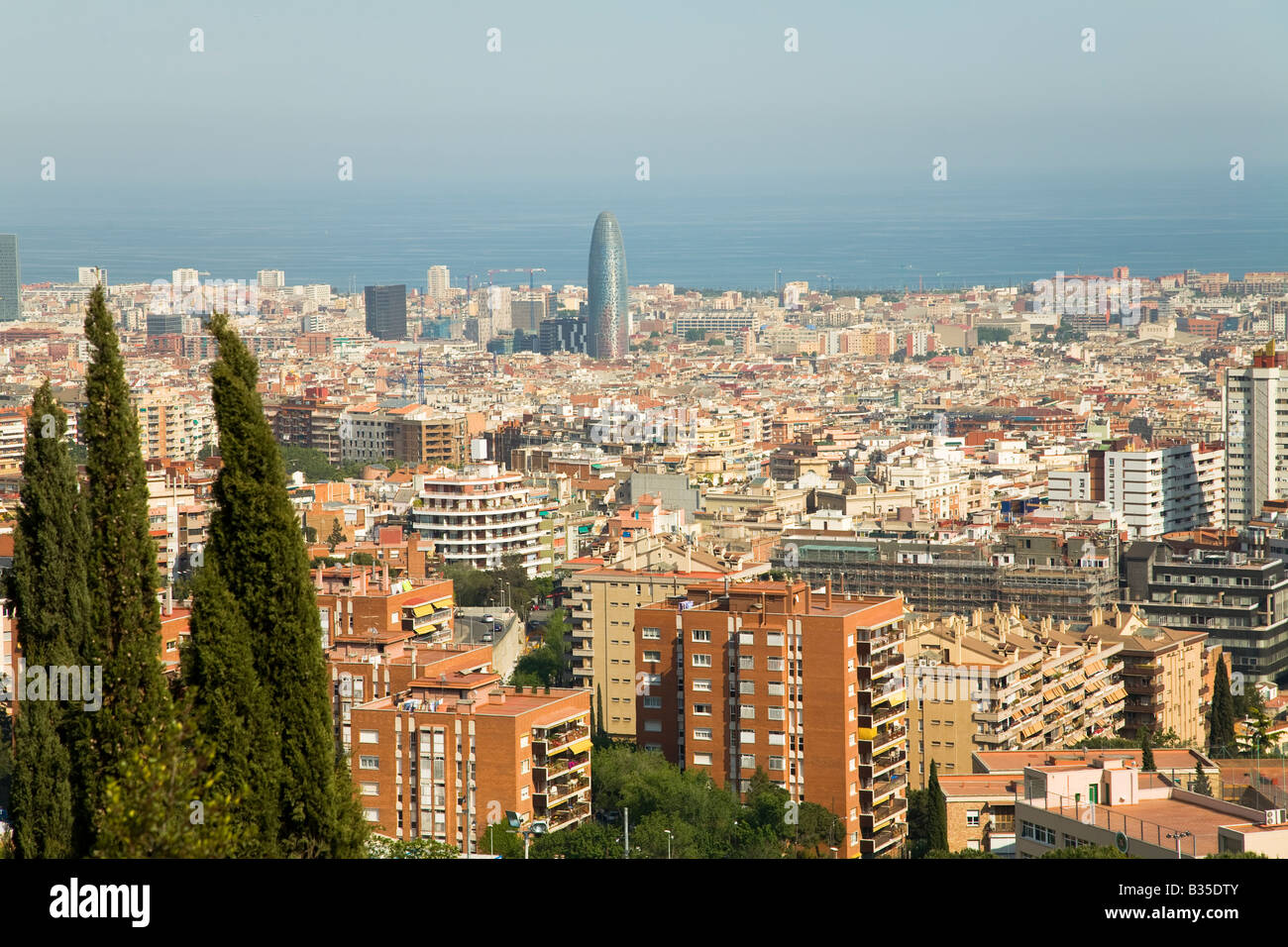 SPAIN Barcelona Overview of city from Parc Guell designed Antoni Gaudi Mediterranean Sea and urban sprawl - Stock Image
