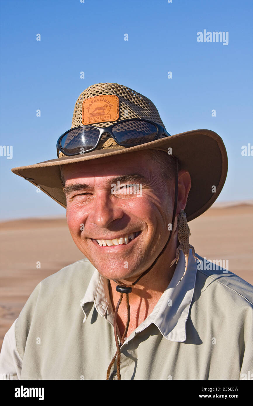 Tommy Collard leads living desert tours among the sand dunes of Namibia near Swakopmund popular tourist town in - Stock Image