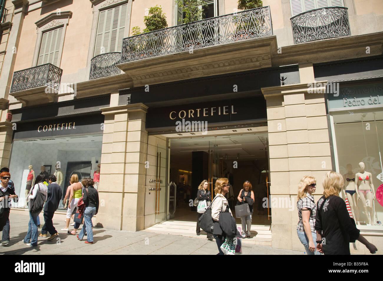SPAIN Barcelona Cortefiel retail store on Passeig de Gracia street high end shopping district pedestrians by entrance Stock Photo