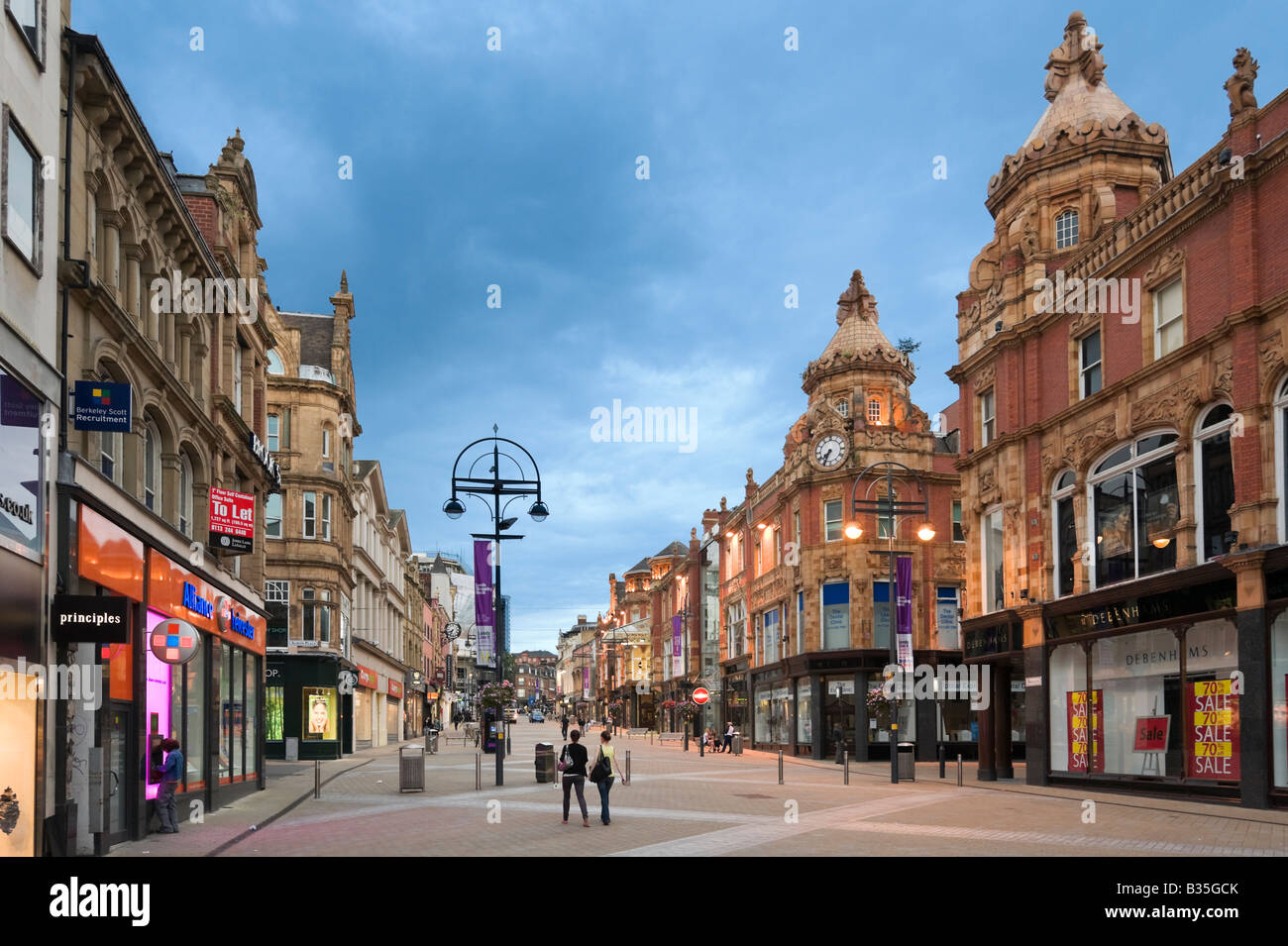 Briggate (the main shopping street in the city centre) in the evening, Leeds, West Yorkshire, England - Stock Image