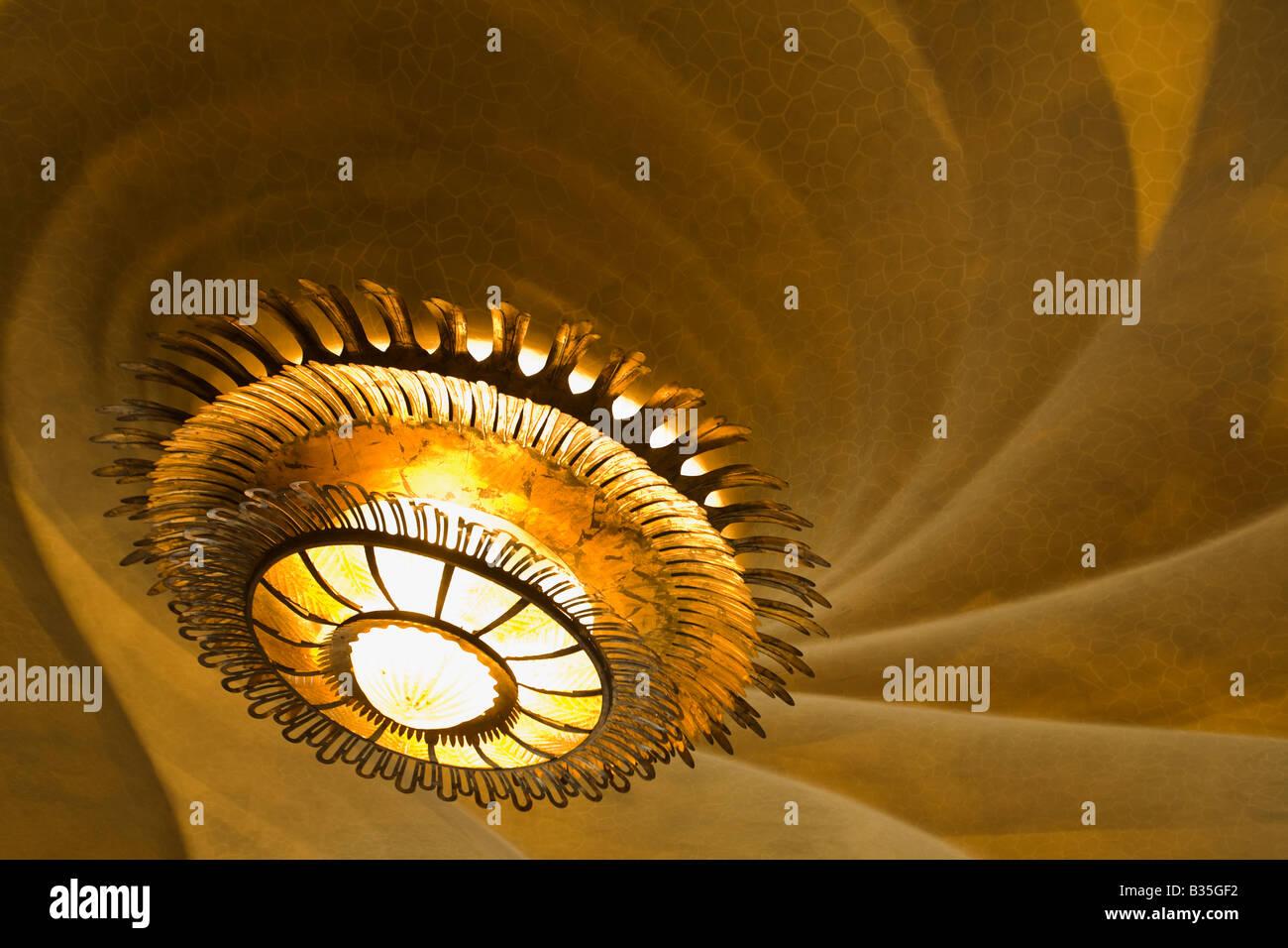 SPAIN Barcelona Metal light fixture in Casa Batllo designed Antoni Gaudi architect Modernisme architecture curved - Stock Image