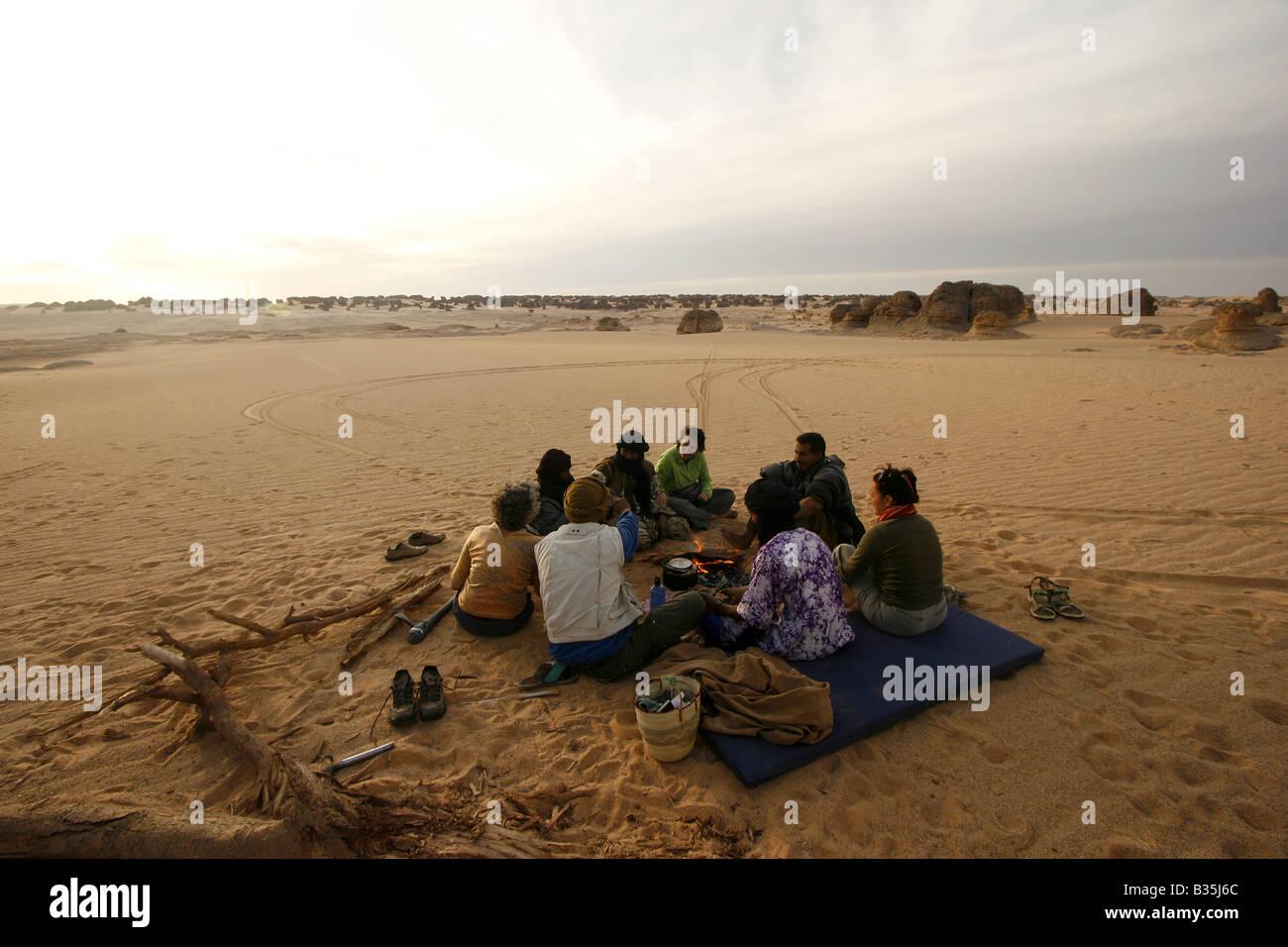 Tourists In Tehog Tassili Ahaggar Sahara desert Algeria - Stock Image