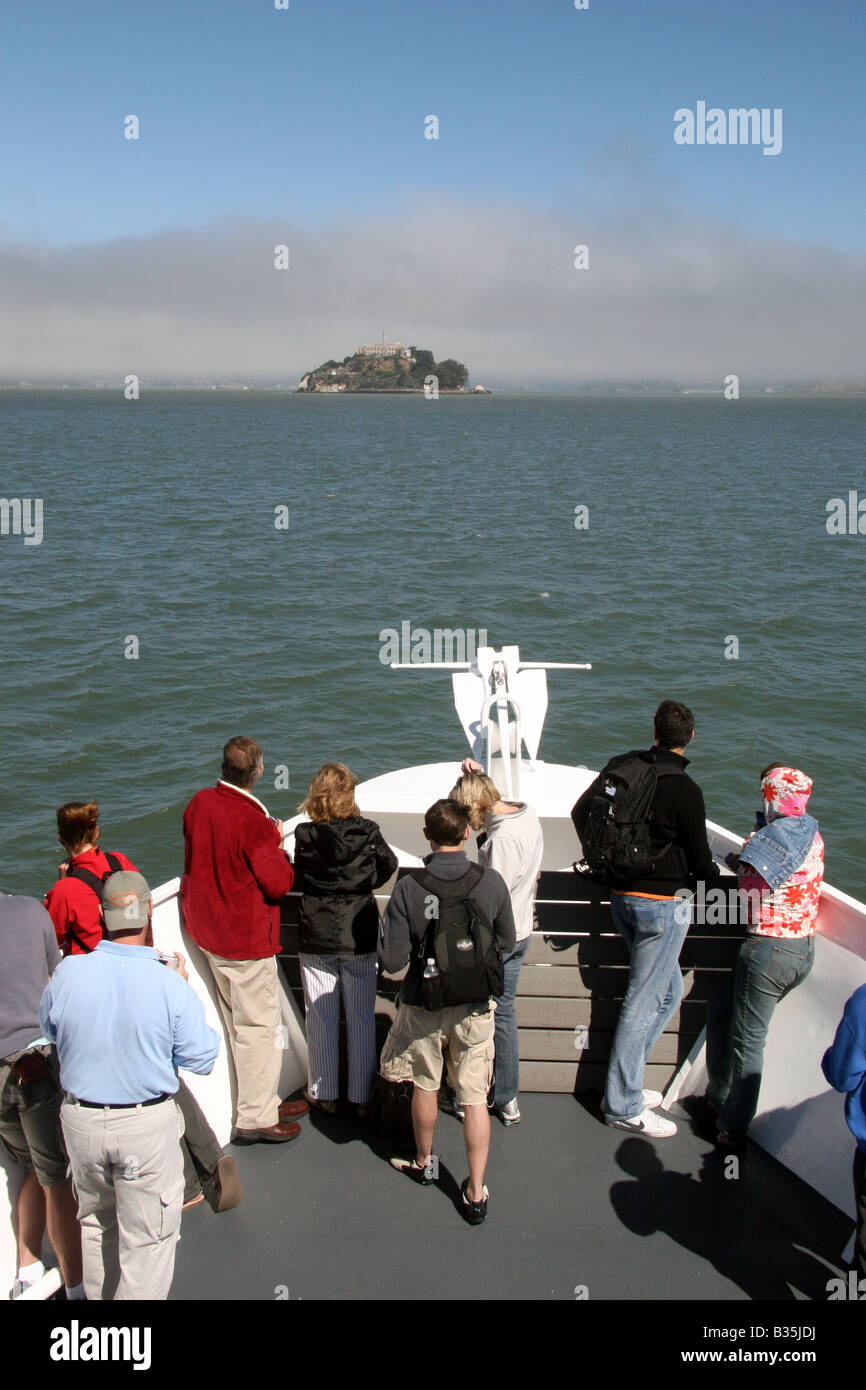 Passengers on the ferry ride to Alcatraz Island, San Francisco Bay, California. - Stock Image