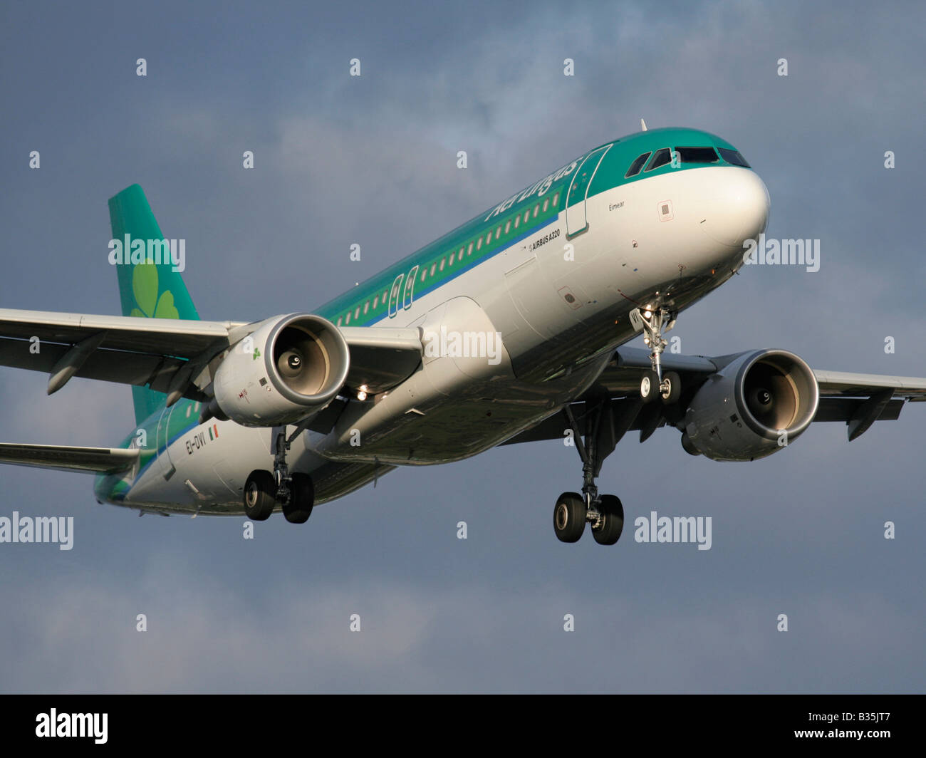 Aer Lingus Airbus A320 twin-engine commercial passenger jet plane on approach. Closeup front view. - Stock Image
