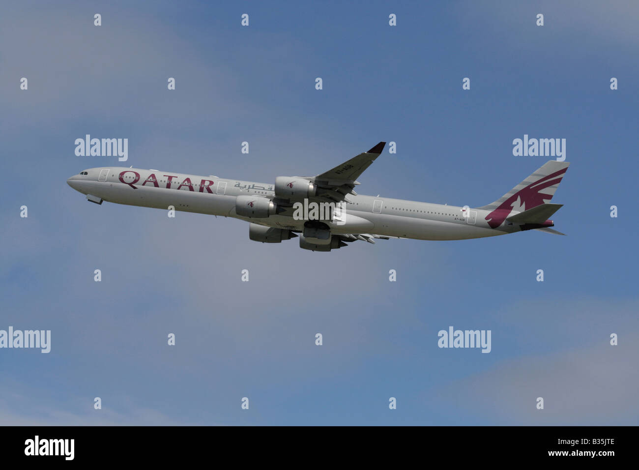 Qatar Airways Airbus A340-600 climbing on departure from Heathrow Airport - Stock Image